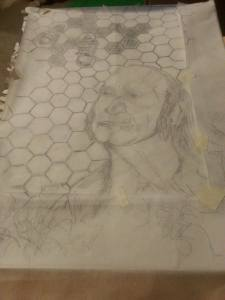 Chapbook cover with tracing paper on top, soon to be transferred to the wood block for carving.